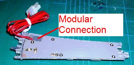 in this approach, you simply cut the red/black modular wire that came with  the turnout and solder the orange and gray wires from the ds51k1 to this  wire